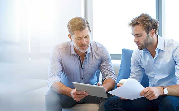 two men discussing a contract