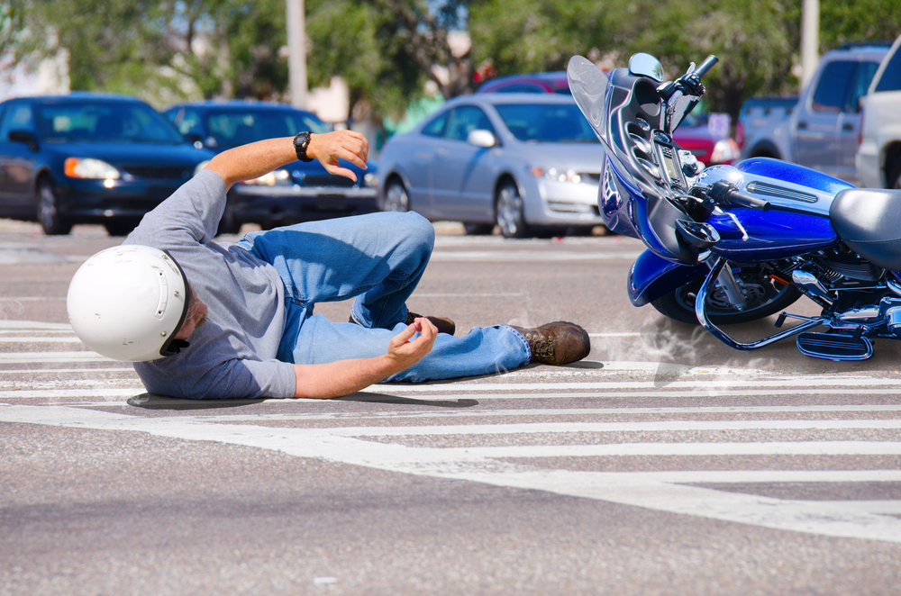 man on the ground after a motorcycle accident